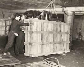 Crates being moved on board ship by hoist