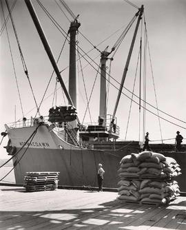 "Vessel ""Mormacdawn"" unloading cargo at dock, Vancouver, British Columbia"