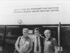 Israel Aspen, Q.C., Colonel Shlomo Kuris, Paul Silver outside Winnipeg Student Health Services Ce...