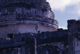 Phyliss Snider posing for the camera while standing on a Mayan ruin