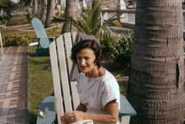 Phyliss Snider sitting on a folding chair