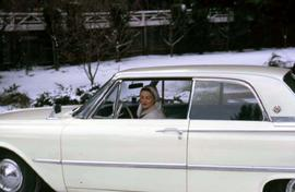 Phyliss in a white car