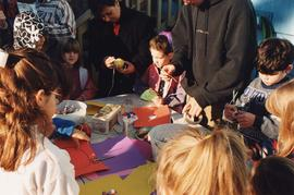 Children making decorations for sukkah