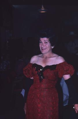 Unknown woman wearing a red and black sequin off-the-shoulder dress