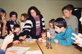 [Group of children eating challah, apples and honey]
