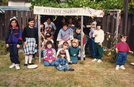 [Sukkot - children in sukkah]