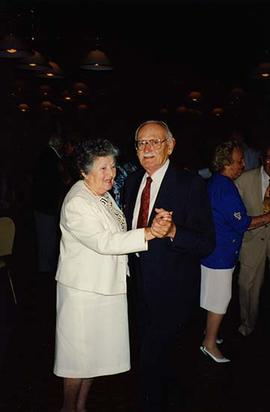 [Unknown man and woman dancing and smiling for the camera at an unknown event]
