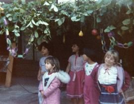 Group of children standing in sukkah