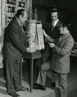 [Cantor Nixon, Harry Sherman and Rabbi with a Torah]