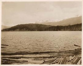 View of mountains and water from route of Pacific Great Eastern Railway, British Columbia