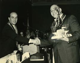 Myer Moscovitch being presented with the Al Jackson - membership award trophy for 1958