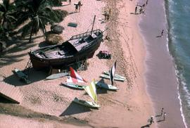 Over head shot of people and boats on a beach