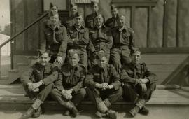 [Group of unknown men and Dr. Irving Snider posing for the camera in their army uniforms]