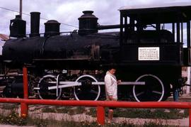 Phyliss Snider in front of the number 51 locomtive of the White Pass and Yukon Route, which has b...