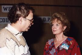 [Bernie Simpson talking with Sylvia Russell]