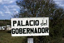 "Sign on a wooden stake that reads: ""Palacio del Gobernador"""