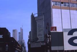 "Billboard with an image of a high-rise that reads: ""Americana of New York, The World's Talle..."