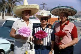 Two unknown men wearing sombreros and Dr. Irving Snider wearing a hat