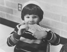 Child eating matzah