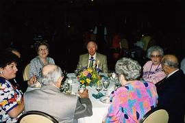 [Unknown people sitting at a table at an unknown event]
