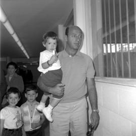 Unidentified man holding child