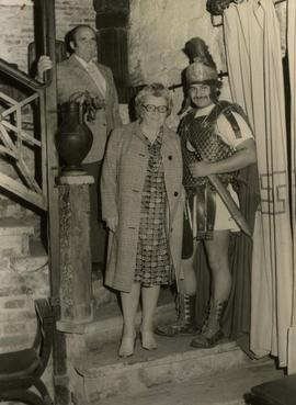 [Ben and Esther Dayson with a man dressed as a Roman soldier]