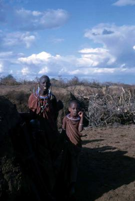 Unidentified Maasai adult and two children