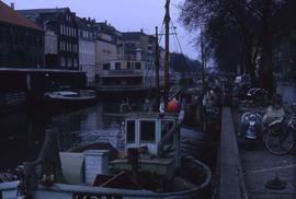 Boats docked in an urban setting