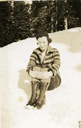 [Esther Nemetz seated in the snow]
