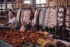 Goods varying from produce to necklaces sold at one stand at the market
