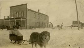Hotel across from Nemetz Store with  baby Milton Nemetz in sled