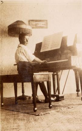 Unidentified boy playing piano