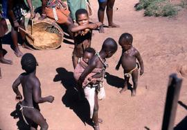 Unidentified South African children playing in traditional ethnic attire