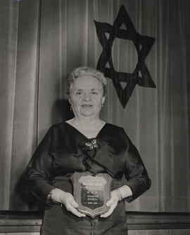 'Queen of Canvassers,' Mrs. [Iora Yorse] holding a plaque