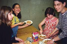 [Three unidentified girls and Susan Katz eating]