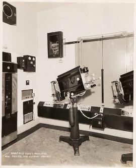 Deaf aid phone amplifier and master fire control station in theatre projection room