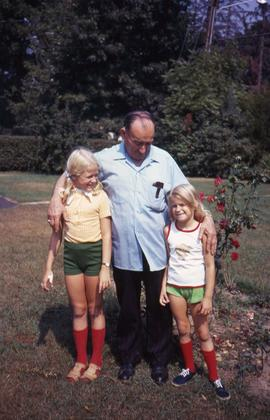 Harry Nemetz and two young girls posing for the camera