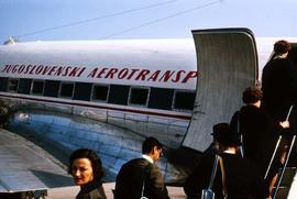 People boarding an airplane, including Phyliss Snider, belonging to Jugoslovenski Aerotransport (...