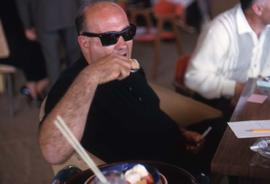 Unknown man eating