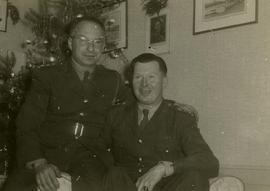 [Dr. Irving Snider and another unknown man wearing army uniforms posing for the camera with a Chr...