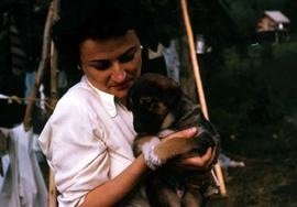 Phyliss Snider holding a puppy