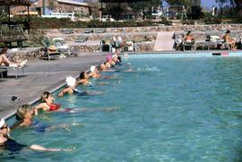 People lined up in a pool