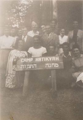 Unidentified adolescents holding the Camp Hatikvah sign