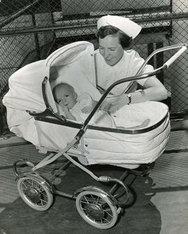 [Baby David in buggy donated by Lion's Gate Lodge]