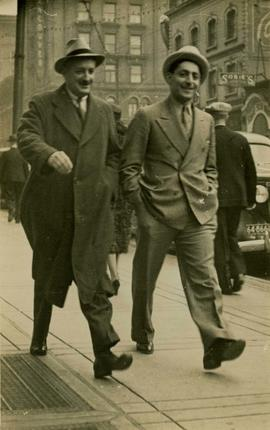 Harry Seidelman and Dr. Margulius strolling in suits