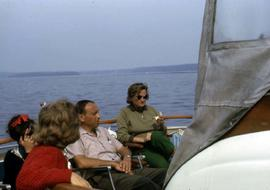 Phyliss Snider and three other unknown people sitting on a boat