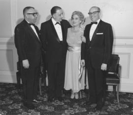Mrs. Lil Shapiro with three men