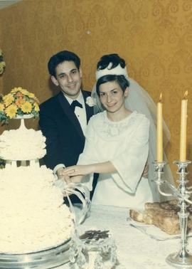 [Shirley Barnett (nee Dayson) and Peter Barnett cutting their wedding cake]