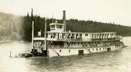 [The boat Caska with people on the deck likely somewhere between Whitehorse and Dawson]