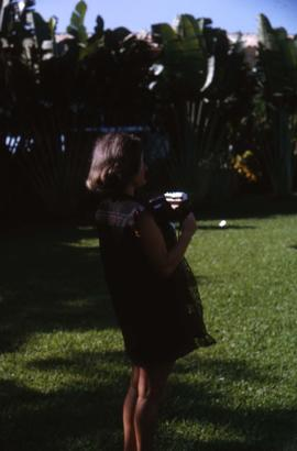 Phyliss Snider holding a camera in her hands
